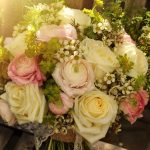 Cream roses and pink ranunculus bridal bouquet