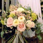 Bouquet with pink roses and white ranunculus