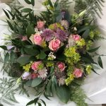 Han-tied bouquet with pink roses and astrantia